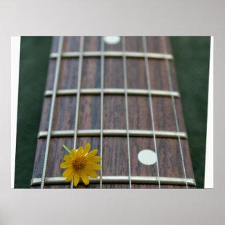 Yellow flower on receeding five string bass neck poster