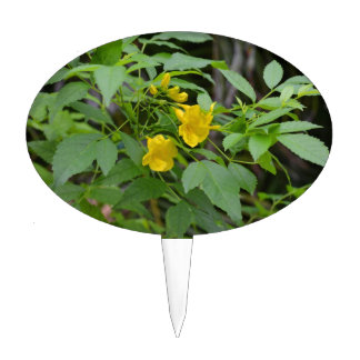 yellow flowers against green leaves cake topper