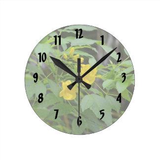 yellow flowers against green leaves clocks