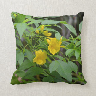 yellow flowers against green leaves throw pillows