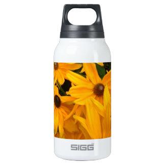 Yellow flowers in full bloom in flower garden insulated water bottle