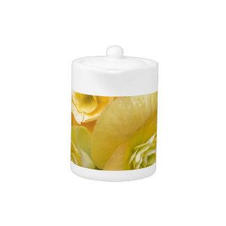 yellow flowers shining teapot