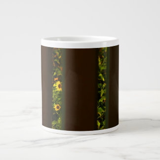 Yellow flowers through wide brown fence large coffee mug