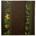 Yellow flowers through wide brown fence napkins
