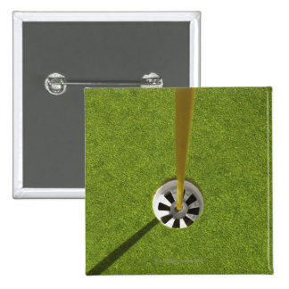 Yellow golf flag pole and hole 2 inch square button
