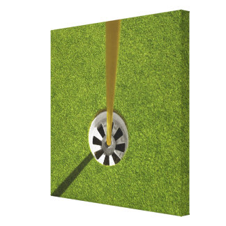 Yellow golf flag pole and hole canvas print