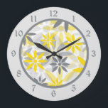 """Yellow Gray Flower Graphic Large Clock<br><div class=""""desc"""">Here&#39;s a pretty graphic style pattern clock that looks great in a kitchen, sun room, or any place where a splash of color is needed. It features a yellow and gray flower pattern as the center. Around the perimeter is a matching light gray frame with darker gray numbers. Be sure...</div>"""
