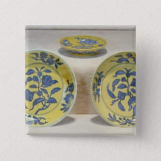 Yellow ground dishes painted in underglaze pinback button