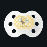 "Yellow Honey Bee | Custom Baby Pacifier<br><div class=""desc"">Custom baby pacifier features a cute smiling bumblebee buzzing over a honeycomb patterned background and includes text that can be personalized with baby&#39;s first name or other wording.  Makes a great baby shower gift or gift for a new mother.  Yellow,  gray,  black and white colors</div>"
