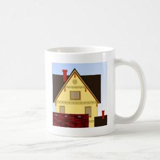 Yellow house coffee mug