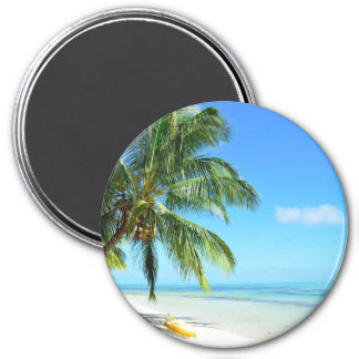 Yellow kayak on a white sand beach round magnet