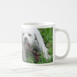 Yellow Labrador puppy playing tug of war Coffee Mug