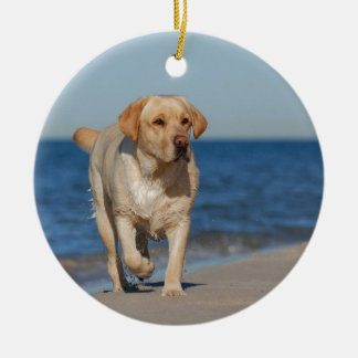 Yellow labrador retriever on the beach Double-Sided ceramic round christmas ornament