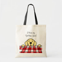 Yellow Labrador watching you bag