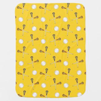 Yellow lacrosse pattern stroller blanket