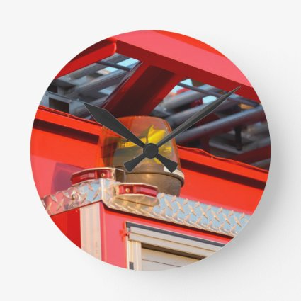 yellow light on fire truck round wall clock