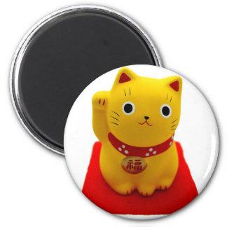 Yellow Maneki Neko on a Red Carpet 2 Inch Round Magnet