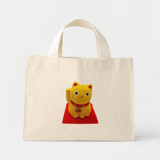 Yellow Maneki Neko on a Red Carpet Mini Tote Bag