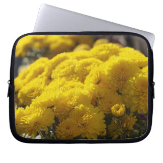 Yellow marigolds bask in sunlight laptop sleeve