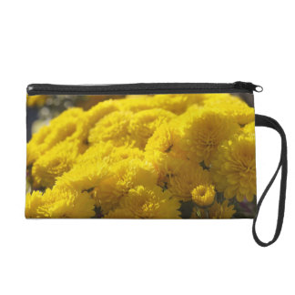 Yellow marigolds bask in sunlight wristlet purse