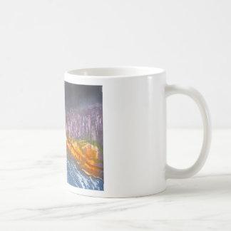 Yellow moon over metamorphic landscape coffee mug