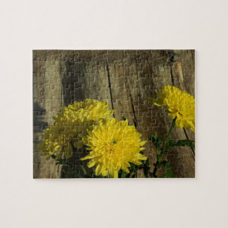 Yellow Mums by a tree stump Jigsaw Puzzle