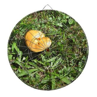Yellow mushroom on a green meadow dartboard