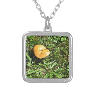 Yellow mushroom on a green meadow silver plated necklace