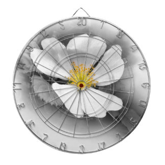 yellow on shades of gray dartboard with darts