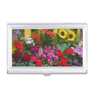 Yellow picket fence with flower garden in business card holder
