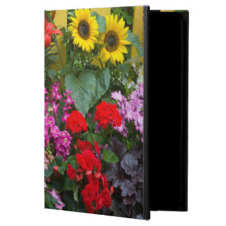 Yellow picket fence with flower garden in iPad air case