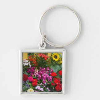 Yellow picket fence with flower garden in keychain