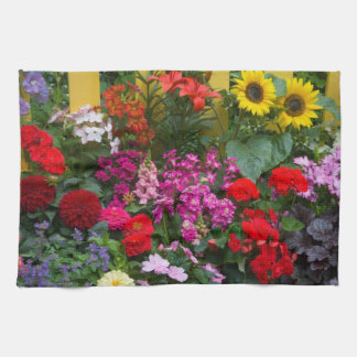 Yellow picket fence with flower garden in kitchen towels