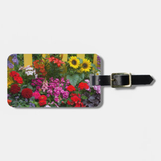 Yellow picket fence with flower garden in luggage tag