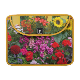 Yellow picket fence with flower garden in sleeves for MacBook pro