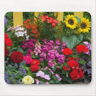 Yellow picket fence with flower garden in mouse pad