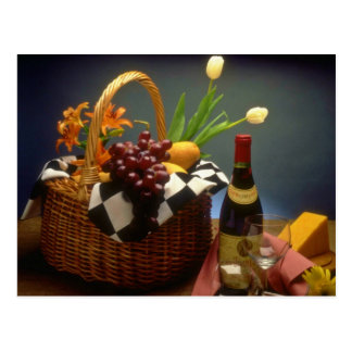 Yellow Picnic basket with wine, cheese, bread and Postcard
