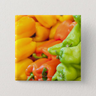 Yellow, red and green pepper on sale at farmer's button