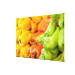 Yellow, red and green pepper on sale at farmer's canvas print