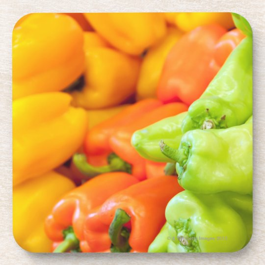 Yellow, red and green pepper on sale at farmer's coaster