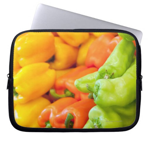 Yellow, red and green pepper on sale at farmer's laptop computer sleeves