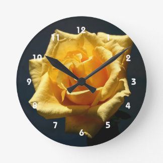 Yellow Rose photograph against dark background Round Clock