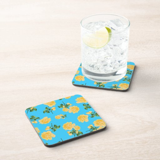 Yellow roses Floral pattern on blue cork coasters