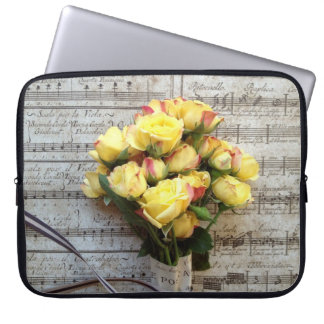 Yellow roses on old music laptop sleeve