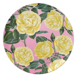 Yellow roses on pink dinner plate