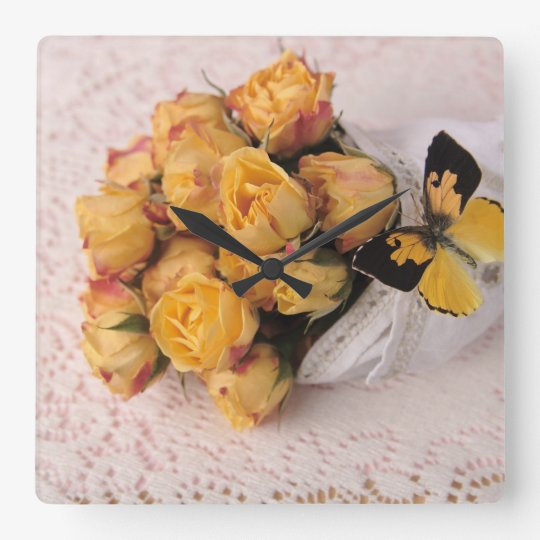 yellow roses with butterfly clock