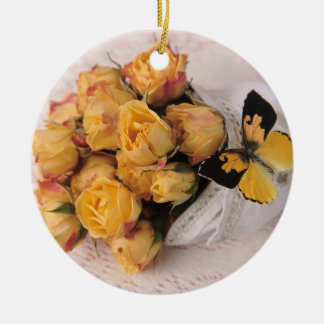 yellow roses with butterfly round ornament