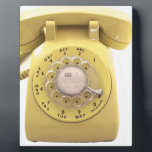 """Yellow Rotary Phone Plaque<br><div class=""""desc"""">Share your digits with this classic design or simply celebrate your love of all things old school with this muted yellow classic style rotary telephone.</div>"""