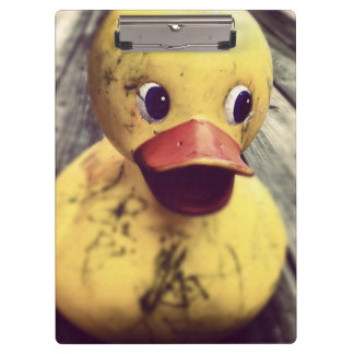 Yellow Rubber Ducky Covered in Dirt! Clipboard