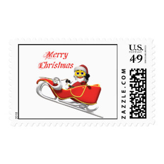 Yellow santa smiley in his christmas sleigh postage stamp